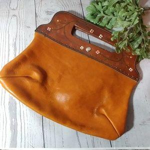 Vintage handmade leather clutch hippy hobo